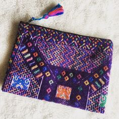 Huipil Clutch/iPad Pouch **New WITHOUT tags RETAIL** Handwoven by indigenous Mayans in the highlands of Guatemala. This pouch is made of huipil fabric. Fits all iPads.  **This item is RETAIL but does not come with tags attached** Bags