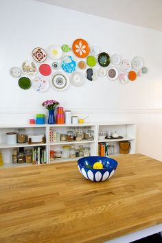 Plate wall, Lisa and Clay's Artsy and Calm Collaboration House Tour via Apartment Therapy