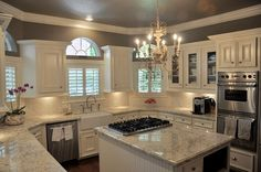 The color of the granite is Bianco Romano  Color of the walls is Stardust by Benjamin Moore-gorgeous!