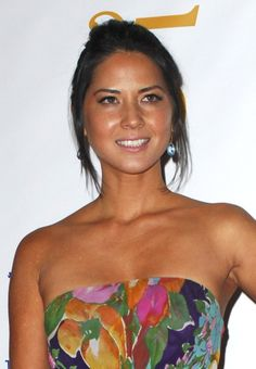Olivia Munns chic, updo hairstyle