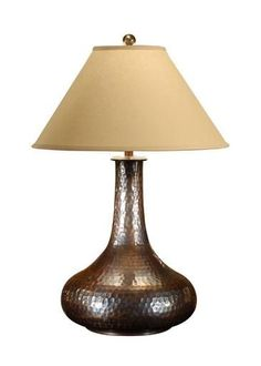 New Table Lamp Product DetailsDimensions (inches):35H x 22W x 8D Bottom of Shade 22W ; Bottom of Shade ; Side of Shade 13.50H ; Top of Shade 8DComment:Hand Hammered Copper With Antique PatinaDate:NewM