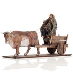 Hombre con carro y buey 8 cm. belén napolitano | venta online en HOLYART Lemax Christmas Village, Christmas Nativity, Donkey, Beautiful Christmas, Cribs, Biscuit, Lion Sculpture, Christmas Decorations, Ornaments