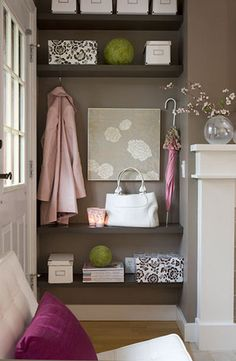 How to Create a Foyer (when there isn't one)- have a bitty spot that is more like a crevice than anything else. Shelving, hooks, and baskets can help to organize your homecomings.