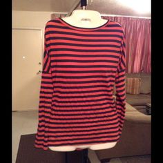 """Lilly Pulitzer Top Lilly Pulitzer Striped Top is both Stylish and Comfortable. This Top is made of 50% Cotton and 50% Polyester.   Size Small. The colors in this Top are: Blue and Orange. It's loose fitting and super Cute. Arm Length """"15.5. Laying flat """"24.5. Length of Top """"26. This item is in Good condition, Authentic and from a Smoke And Pet free home. All Offers through the offer button ONLY. I Will not negotiate Price in the comment section. Thank You😃 Lilly Pulitzer Tops"""
