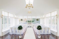 Classical elegance achieved in this set up at Carlowrie Castle, Kirkliston. White and Ivory provide a beautiful warmth, and all that is needed in the stunning orangery. www.zenith-events.co.uk