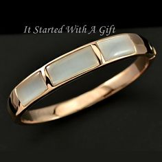 18K Rose Gold Plated Bangle with Imitation Mother Of Pearl    Bangle dimensions: 5.7cm X 4.5cm wide  Weighs app 43grams  Push on the button to open clasp    Only $30.00 plus Shipping World Wide   Shop this product here: http://spreesy.com/itstartedwithagift/18   Shop all of our products at http://spreesy.com/itstartedwithagift      Pinterest selling powered by Spreesy.com
