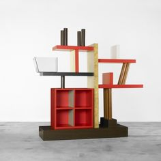 ETTORE SOTTSASS    Liana bookshelf    Meccani  Italy, 1988  stained oak, lacquered wood, quilted maple, mahogany, glass  85 w x 23.5 d x 88.5 h inches