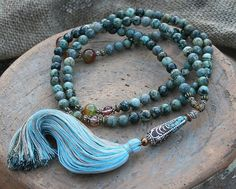 Mala necklace made of 108, 8,6 mm - 0.338 inch, beautiful African turquoise gemstones and decorated with agate, faceted cherry quartz and a