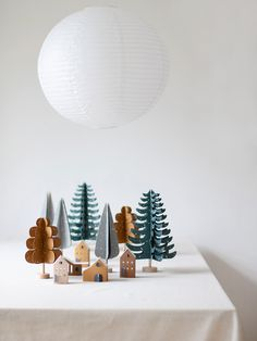 The new paper trees in my webshop are a perfect match with the village of tiny houses... Everything is pre cut and prefolded and super easy to assemble. And flat (max A4), so it's a perfect mailbox gift. There's a FIR, CYPRESS and OAK tree, the village is called TÛS tiny houses. Cozy Christmas, All Things Christmas, Christmas Crafts, Christmas Decorations, Fir Tree, Xmas Tree, Tree Cut Out, Babyshower, Wooden Decor