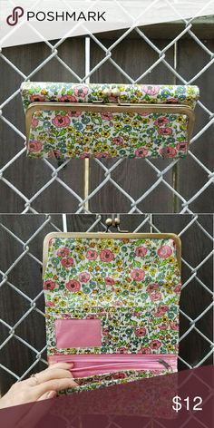 """Modern vintage-look floral clutch Laminated fabric, multi-colored with pink lining and multiple inside pockets. Outer magnet closure. 8 1/4"""" x 1"""" x 4 1/4"""" Bags Clutches & Wristlets"""