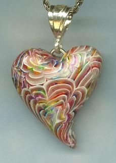 Elissa Powell created this gorgeous pendant using her Chrysanthemum Cane from pcPolyzine, December 2000. http://www.pcpolyzine.com/2000december/chrysanthemum.html