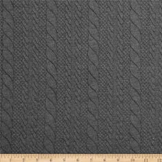 """Keep warm with this unique lofty knit fabric! This """"sweater knit"""" is actually a double cloth knit with a cable-look quilted rayon jersey knit face and a smooth polyester jersey backing. With 25% stretch across thr grain, this fabric is perfect for creating dresses, skirts, and jackets."""