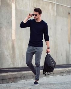 Marry a deep blue crew-neck pullover with grey jeans to create a great weekend-ready look. This outfit is complemented perfectly with black slip-on sneakers.