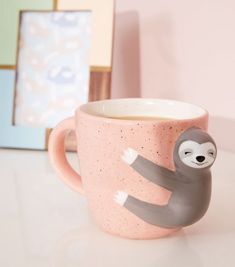 Coral Speckle Smiley Sloth Mug New Look Make your brew a bit more sweet with this smiley sloth mug. - Sloth shape - Speckled print - Curved handle - Perfect as a gift Measurements: - Height: 4