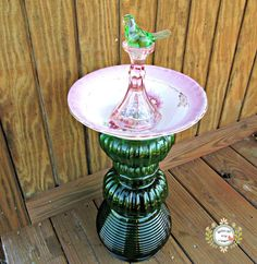 Use coupon code: PIN10 for 10% off! Vintage Albright pink floral bird bath made with vintage green glass pedestal, Fostoria depression pink glass candle stick holding a green glass bird.  Beautiful accent to ...