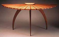 Sunburst Table, Seth Rolland.  Walnut legs w/ top of walnut, cherry and maple tapered laminations