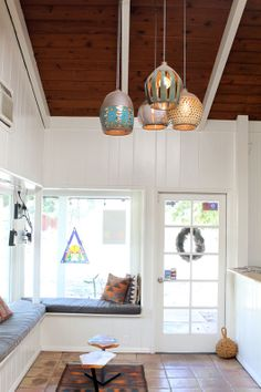 Love the pottery pendant lights!
