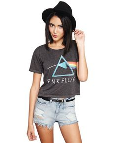"""<p>Throw it back to the 1970s with this vintage-inspired band tee. It features a screen print of Pink Floyd's™ famous """"The Dark Side of the Moon"""" album, an incredibly soft knit body, short sleeves, and a boxy fit. Rock it like a true vintage queen with cutoff denim shorts, a wide brim hat, and booties!</p>  <p>Model wears a size small.</p>  <ul> <li>60% Cotton / 40% Polyester</li> <li>Machine Wash</li> <li>Imported</li> </ul>"""