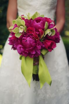 Bold Colors with Peony, Orchid, and Rose, I would love this with blue hydrangea sprayed with aqua/teal color and feathers or...little peacocks! and minus the roses