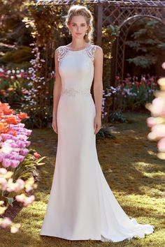 This Rebecca Ingram crepe sheath wedding dress features a jewel neckline and beaded lace motifs.