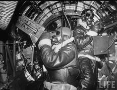 Inside a B-17 Flying Fortress bomber a radio operator & an engineer WWII , life archives