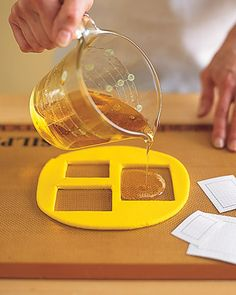making windows Roll out molding clay 1/4 inch thick on a Silpat. Measure windows of house; add 1/2 inch all around. With a utility knife, cut out molds from clay using measurements. Make the Caramel Syrup, and pour into molds. Let set in molds until completely dry, about 1 hour. Carefully lift clay, leaving windowpanes behind.
