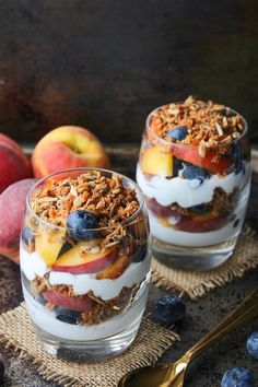 Blueberry & Peach Parfaits - filled with layers of coconut whipped cream, grain free cinnamon granola, and fresh summer fruit. Paleo & Vegan