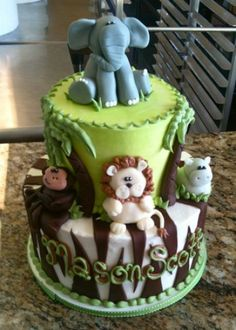 Celebration Cakes : Mary's Cakes & Pastries  Jungle Cake  Two double layer tiers covered in buttercream with fondant details and figures.  Number of Serving: 30  Occasion: birthday cake , baby shower