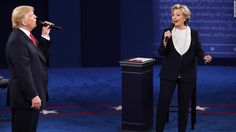 New Hampshire poll: Clinton leads Trump by 15 points Democratic presidential nominee former Secretary of State Hillary Clinton and Republican presidential nominee Donald Trump speak during the town hall debate at Washington University on October 9, 2016, in St. Louis.
