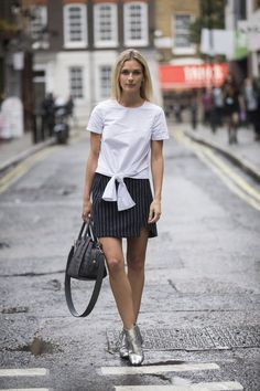 Spotted on day 2 of LFW (SS17): Naomi Ross from @rossio_style showing us how to wear pinstripes, tie front tees & metallic boots.