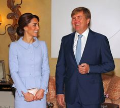 Kate shares a joke with King Willem-Alexander as the pair pose for photos before sitting d...