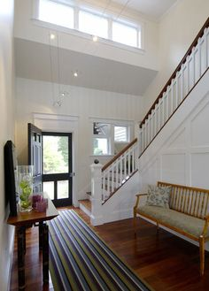love this staircase, and whole front entry. Lovely railing and windows, even the runner looks great.