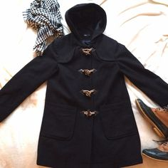 Asos Toggle Coat Stylish black toggle coat from Asos. This is a mid weight coat, great for Fall! Pre-loved, with minor pulling which could easily be removed with some patience, last picture is to show the extent. Feel free to ask questions or make offers!  ⭐️other items for staging⭐️ ASOS Jackets & Coats