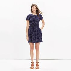 """A simple silk dress with a party-in-the-back situation—a crisscross cutout that reveals just a hint of skin. We love the subtle print mix of polka dots and stars. <ul><li>Waisted.</li><li>Falls 36 1/4"""" from highest point of bodice.</li><li>Silk.</li><li>Dry clean.</li><li>Import.</li></ul>"""
