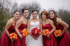 Red was a dominant theme of the wedding, as seen in the bridesmaid dresses.