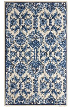 "Make your floor a dramatic botanical backdrop with Pier 1's Torlan Wool Rug. Its all-over indigo floral pattern on a cream field is the epitome of cool sophistication. And it offers classic comfort by way of its hand-tufted wool construction. Come to think of it, you might want to feature this ""backdrop"" front and center."