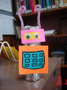 Robot Craft - aluminum foil - must use tape to stick things on foil, glue stick to stick things on paper