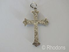 Hollow sterling silver crucifix with beautiful chased design to the front, circa 1920s.  Impressed marking to the back
