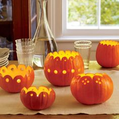 Set a bewitching table with one or more scalloped pumpkin votives in a variety of sizes and designs. - FamilyCircle.com