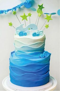 "An eco-friendly Whale Themed Baby Shower with a blue ombre whale topped cake, honeycomb lanterns, a ""Baby Boy"" banner, and more! We love this idea! Ombre, blue waves."