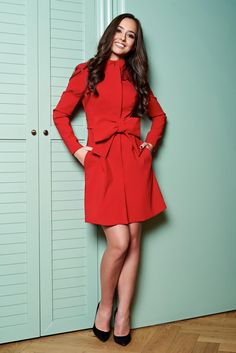 Artista Flame Desire Red Trenchcoat, accessorized with tied waistband, bow shaped accessory, inside lining, elastic and fine fabric, fastened with buttons