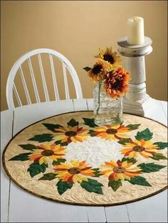 Such a pretty table topper with a ring of cheery flowers!