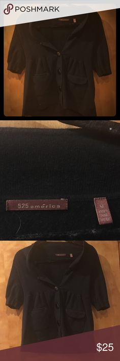 525 America black sweater 3/4 length Cute black 525 America sweater, barely worn. Three buttons in the front and a pocket on each side. Perfect to put over a little cami. Size Medium. 3/4 length or a little shorter sleeve. 525 America Sweaters V-Necks
