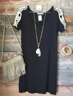 Walking thru the Garden Tunic Dress: Heather Olive is the perfect summertime staple! With crochet lace sleeves, super soft fabric, and a lovely fit, you will definitely be impressed! Add your favorite