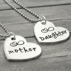 """These charming mother daughter necklaces are the perfect gifts for Mothers Day or any other day! Features & Measurements: ♥ 7/8"""" Heart Charms ♥ 24"""" Stainless Steel Ball Chain ♥ Includes 2 Necklaces ♥"""