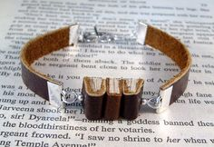 Hey, I found this really awesome Etsy listing at https://www.etsy.com/listing/177891549/miniature-book-bracelet-the-stacks-stack