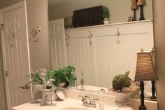 Transformed a plain, long wall in our upstairs bath by adding thick beadboard, trim and a shelf.
