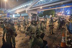 Umbrella Revolution Hong Kong, News Photo : Riot police stand guard outside of Hong Kon...