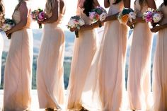 I love the neutral bridesmaid dresses with a colorful bouquet!