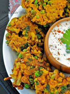 Indian Spiced Cauliflower, Potato & Pea Fritters w/ Yogurt Sauce.